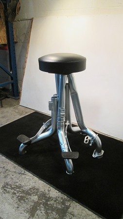 Bar stool w/ round black seat and silver exhaust legs