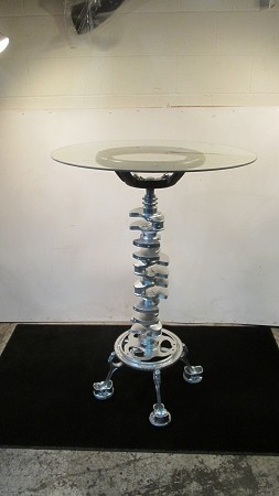 bar table, glass w/ silver crank shaft and leather steering wheel stand
