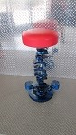 Bar stool w/ red seat and blue crank shaft stand