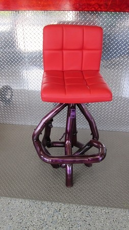 Bar stool w/ red seat and purple exhaust legs