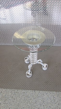 Side table glass w/ silver pistons and springs stand